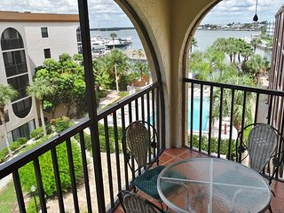 Top Floor Unit with Pool and Bay Views