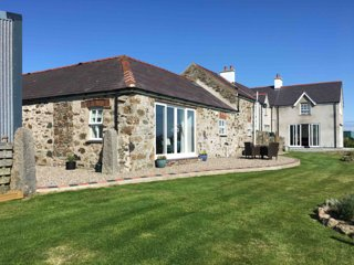 Erw'r Asyn. Barn conversion with sea views of Church Bay
