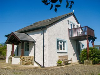 ARCHERS COTTAGE, detached barn conversion, woodburner, balcony, lawned garden