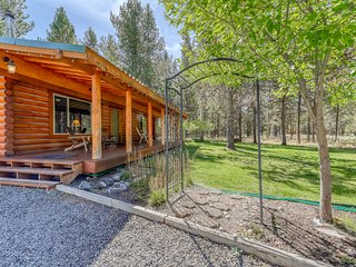 Rustic, dog-friendly log cabin w/ a full kitchen, wood stove, & private hot tub
