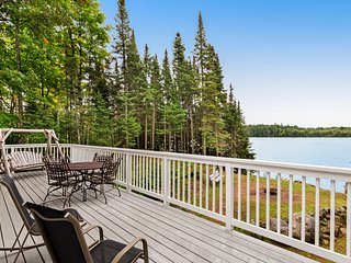 NEW LISTING! Beautiful home on High Lake w/private pier, large deck & canoes