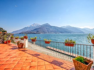 Italian lakefront home with entertainment, private deck & stunning views!