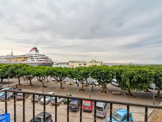 Modern apartment w/ balcony & harbor views - walk to the beach & dining!