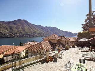 Enjoy gorgeous views of Lake Como from the private terrace of this lovely villa!
