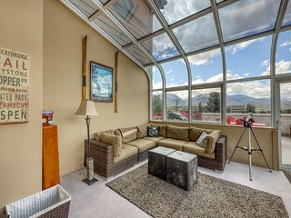 Mountain views from the balcony - laundry, fireplace & parking included!