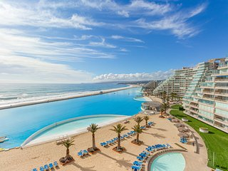 High-end, beachfront resort apt. w/ocean views & shared pool and more amenities!