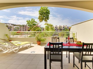 Modern condo with two huge patios, pool access, golfing, and tennis