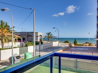 Stylish condo with shared pool, private balcony, ocean views - walk to the beach