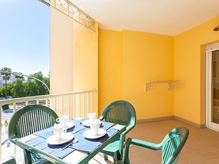 Bright and sunny apartment with a furnished balcony, sea view, and shared pool