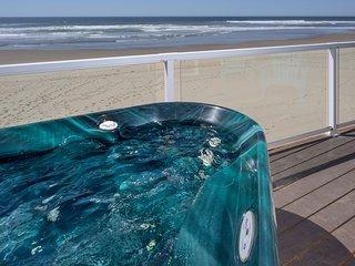 BRAND NEW!! Beachfront Spa-Style Condo, Private Hot Tub & On Site Beach Access