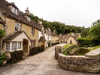 A picturesque 15th century 3 storey stone cottage in  Castle Combe village