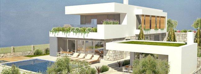 Villa espaçosa e elegante para 10 pessoas, totalmente climatizada, com PS4, cozinha de verão, Wi-Fi gratuito