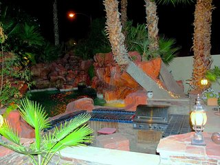 Pool resort and barbecue area at night