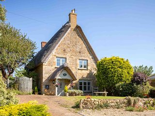 Honeysuckle Cottage is a beautiful grade II listed thatched cottage