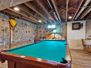 Lovingly restored, historic home on 160 acres w/ game room & dock!