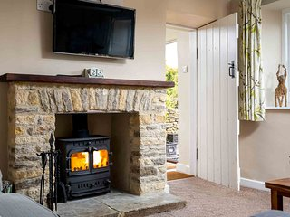 ...and a stone fireplace with a cosy wood burning stove