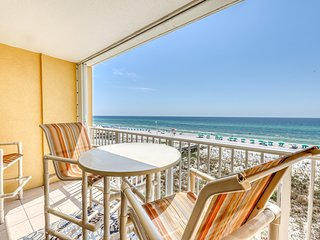 Family-friendly beachfront condo with shared pool and beach access