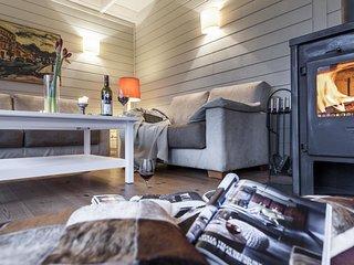 traumHaff Romantisches Lotsenhaus mit Kamin, Sauna und Boot in Rieth am See