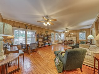 Dog-friendly, lakeview lodge w/ a shared pool, furnished deck, & enclosed yard