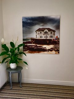 Artwork depicting local sights and scenes are displayed prominently throughout the property.