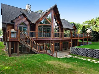 NEW LISTING! Luxury lakefront home w/ private dock, beach access, kayaks & bikes