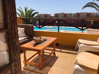 Lovely apartment with sea and swimming pool views in gated complex