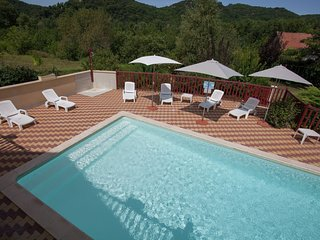 Holiday home right on the river bank with private swimming pool in Saint-Julien-