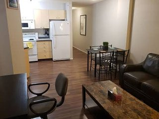 Private condo with work desk and underground parking