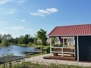 Beautiful home with a veranda and jetty, located near a pond