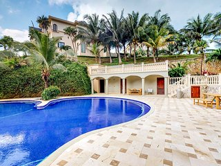 Bright villa w/ private deck, shared tropical pool & easy West Bay Beach access!