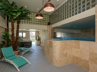 Rural apartment with swimming pool, sauna and fitness centre near the beach