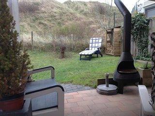 Cosy holiday home with sauna by the dunes near the sea and beautiful dune garden