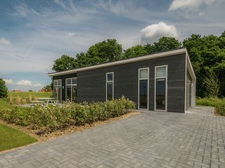 Modern chalet at the edge of a forest near the Oosterschelde