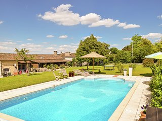 Traditional farmhouse with pool in the middle of the French countryside.