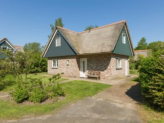 Great thatched villa with solarium, in a national park