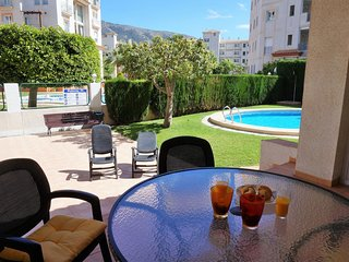 Light apartment with communal pool and walking distance to the beach