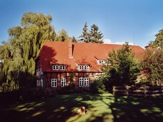 Historic half-timbered farmhouse in the Luneburg Heath with wood stove