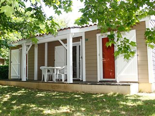 Detached chalet with a covered terrace in green surroundings