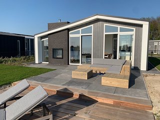 Modern chalet with jetty and terrace near the Oosterschelde