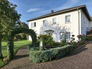Modern property in lovely, immaculate white country house.