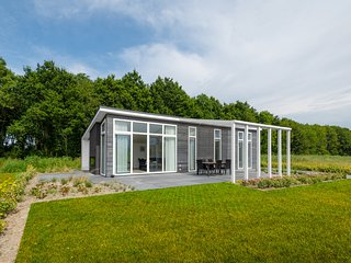 Chalet with a see-through fireplace near the Oosterschelde