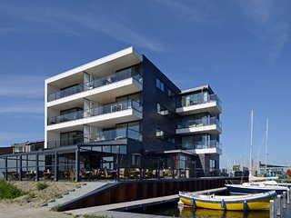 Modern apartment with balcony and magnificent view across the Veerse Meer lake