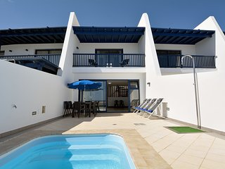 Comfortable, attached holiday home with private pool and near the sea