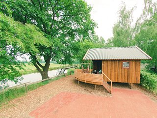 Charming cottage with a terrace, at the river De Regge
