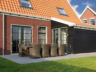 Holiday home in traditional style of Zeeland province, with sauna and Sunshower