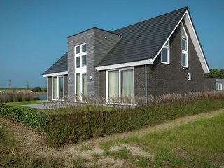Stylish holiday home with a fireplace near the Oosterschelde
