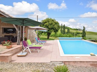 Spacious villa with large terraces and private pool, set in rural surroundings.