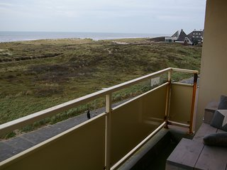 Holiday apartment with a view of the dunes, sea, and lighthouse
