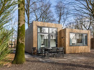 Modern lodge with combi-microwave within green surroundings