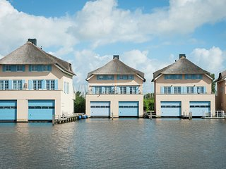A luxury link-detached villa with boathouse and jetty, close to Stavoren
